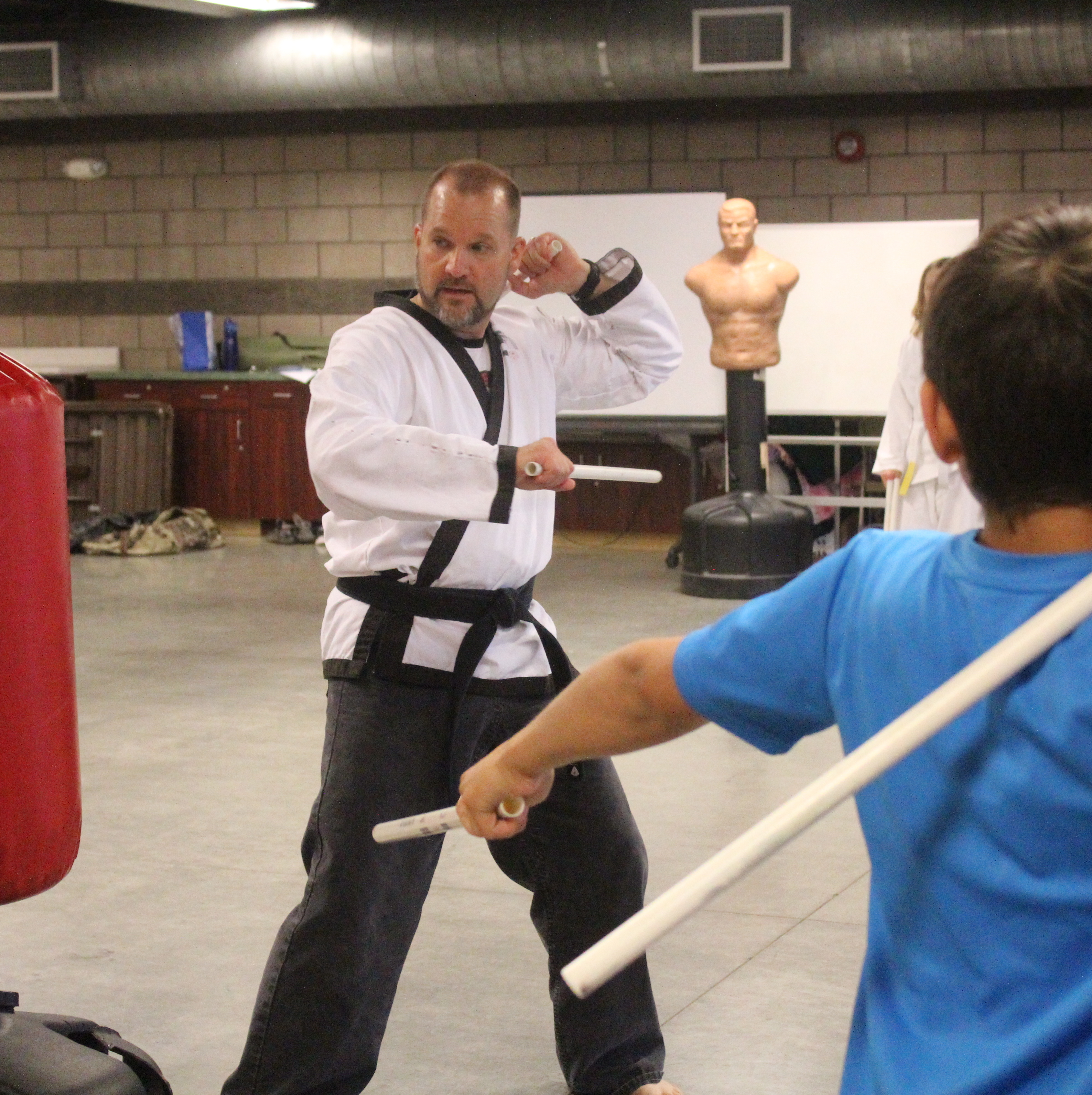 Local youth training with a martial arts instructor.