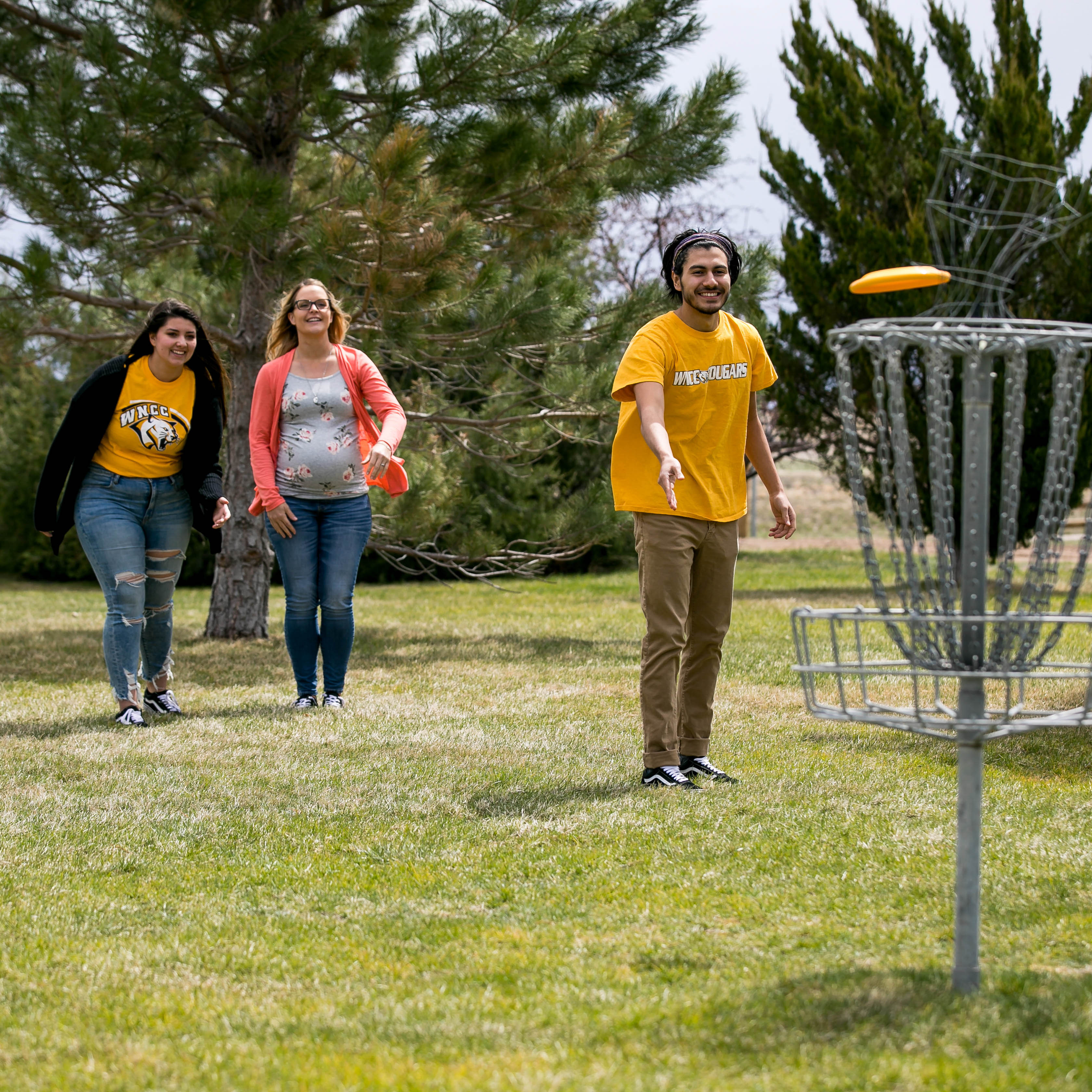 wncc sidney students playing disc golf